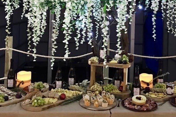 Platters of local cheeses, sliced deli meats and fresh fruits at the launch of Oastbrook Ros? 2015
